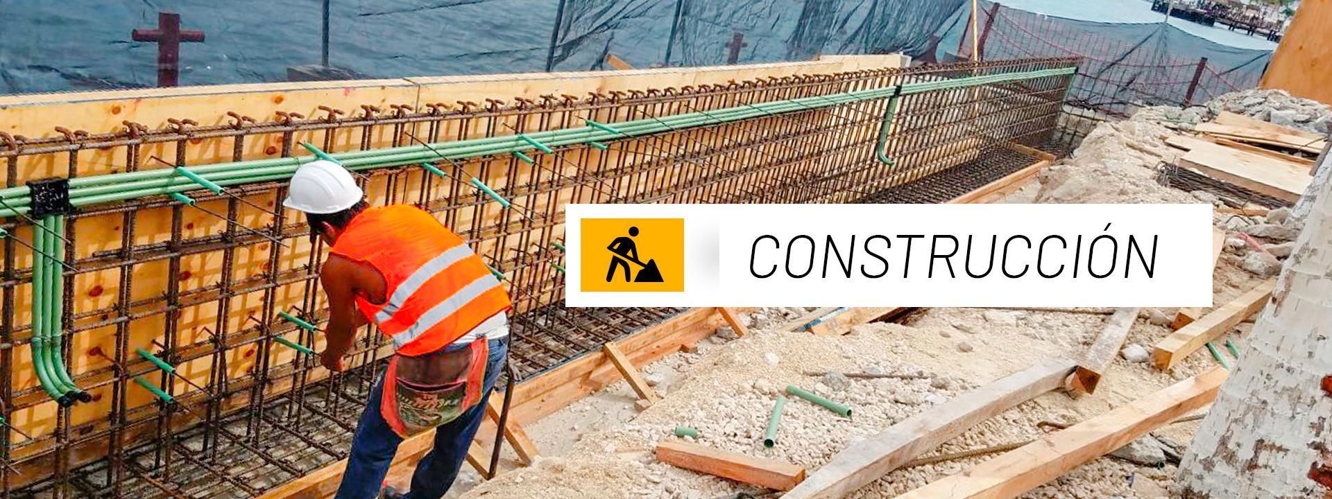 portada de construcción hombre construyendo a la orilla del mar